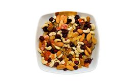 Bowl of mixed sultanas - isolated Stock Photography
