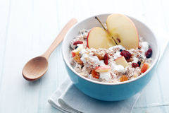Bowl of muesli, apple, fruit, nuts and milk Stock Images