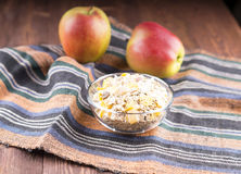 Bowl of muesli, apple, nuts, flakes, candied  for a nutritious b Stock Images