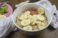Bowl of muesli with banana Royalty Free Stock Images