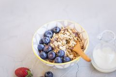 Bowl of muesli with blueberries fruits, healthy breakfast with o stock images