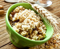 Bowl with Muesli Cereals and Wheat Ear royalty free stock photography