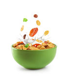 Bowl of muesli and dried fruit isolated on a white background. Stock Images