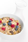 Bowl of muesli with fresh berries an milk Royalty Free Stock Image