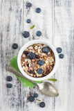 Bowl of muesli with fresh blueberries on white wooden table Stock Photography