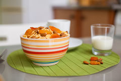 Bowl with muesli and a glass of milk on the table Stock Photo