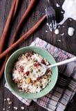A bowl of muesli. Portrait of a bowl of muesli served with yogurt Stock Photo
