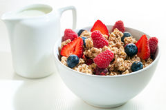 Bowl of muesli with red fruit. Royalty Free Stock Photo