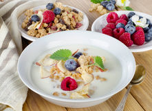 Bowl of muesli and yogurt with  berries Royalty Free Stock Image
