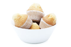 Bowl with muffins. Isolated on white background Stock Images
