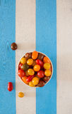 A bowl with multicolored fresh ecologic tomatoes. Royalty Free Stock Photos