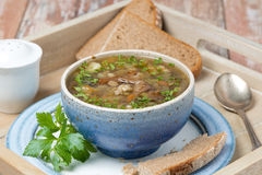 Bowl of mushroom soup with pearl barley on a tray Stock Photo