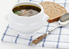 Bowl of mushroom soup with spoon and bread Royalty Free Stock Images