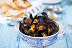Bowl of mussels. Steamed in white wine sauce stock photos