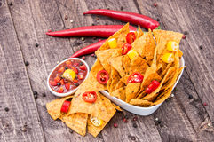 Bowl of Nachos with Salsa Sauce Royalty Free Stock Photography