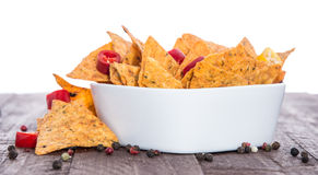 Bowl of Nachos on white and wood Stock Photography