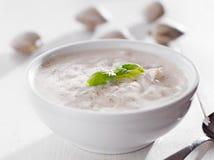 Bowl of new england chowder with basil garnish. stock photo