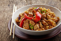 Bowl of noodles with chicken and vegetables royalty free stock image