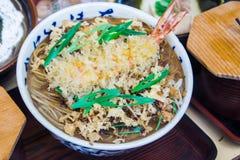 Bowl of noodles with prawn tempura Stock Photos