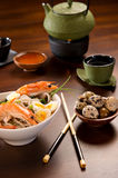 Bowl of Noodles with prawns & tea Stock Images