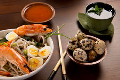 Bowl of Noodles with seafood & tea Stock Photos