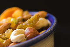 Bowl of nutrition. A bowl of assorted nut and fruits Royalty Free Stock Photography