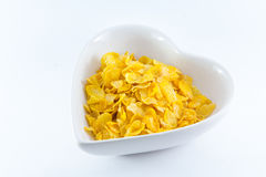 A bowl of nutritious and delicious corn flake cereal Royalty Free Stock Image