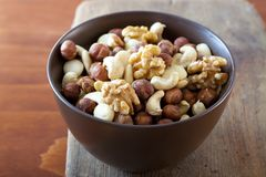 Bowl with nuts Stock Photos