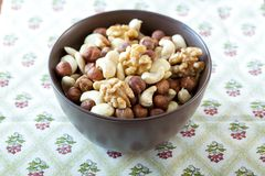 Bowl with nuts. Bowl with four sorts of nuts stock photos