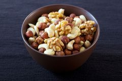 Bowl with nuts. Bowl with four sorts of nuts Royalty Free Stock Photos