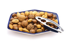 Bowl of nuts. Bowl of mixed nuts on white Royalty Free Stock Photo