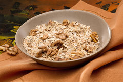 Bowl with nuts and muesli Royalty Free Stock Photos