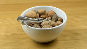 Bowl of nuts with nutcracker Royalty Free Stock Photography