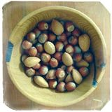 A bowl of nuts Stock Images