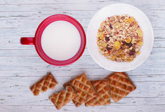 Bowl of oat flake, milk and cookies. On wooden background Stock Photo