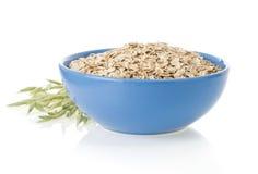 Bowl of oat flake on white Royalty Free Stock Photo