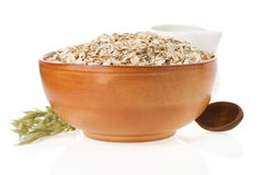 Bowl of oat flake on white Royalty Free Stock Image