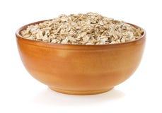 Bowl of oat flake on white Royalty Free Stock Photos