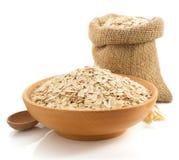 Bowl of oat flake on white Stock Photo