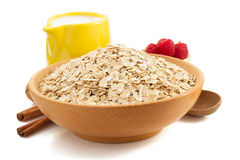 Bowl of oat flake on white Royalty Free Stock Photography