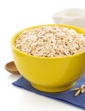 Bowl of oat flake on white Stock Images