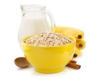 Bowl of oat flake on white Royalty Free Stock Image