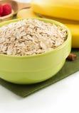 Bowl of oat flake on white Stock Photos