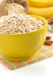 Bowl of oat flake on white Royalty Free Stock Images