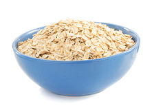 Bowl of oat flake on white. Background Stock Image