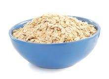 Bowl of oat flake on white Stock Image