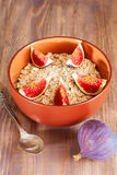 Bowl of oat flakes with figs Royalty Free Stock Photos