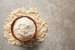 Bowl with oat flour. On gray background Stock Photography
