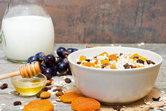 Bowl of oat muesli with fruits, berries, honey and nuts Stock Photography
