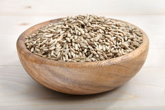 A bowl of oat on wooden surface Stock Image